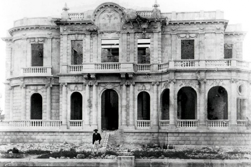 Pilavakis in front of his under construction mansion.