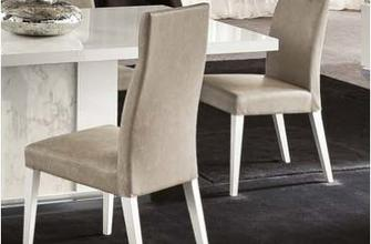 The elegant ALF Canova Dining Chair features an upholstered seat and curved, tufted back cushion. Pair with the matching dining table to create a stylish complete set.