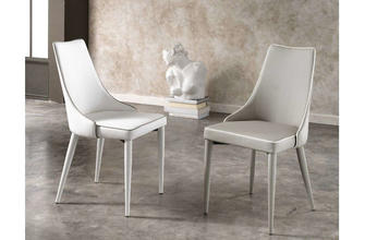 Padded chair with a metal structure and upholstered with leatherette with the bord in contrast