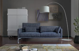 The Genius Loci, also available in a chaise-longue configuration, features a stylish shape, further enhanced by slender armrests and elegant feet