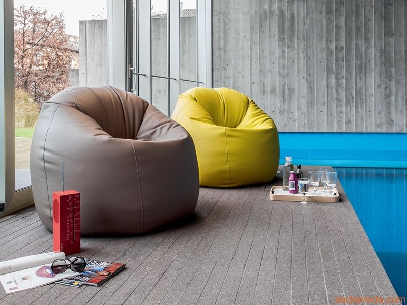 "Eco-leather covered pouf / armchair, stuffed with a mix of polystyrene beads. Dynamic and easy to fit into any domestic ambient, it's a true Tonin Casa ""must"""