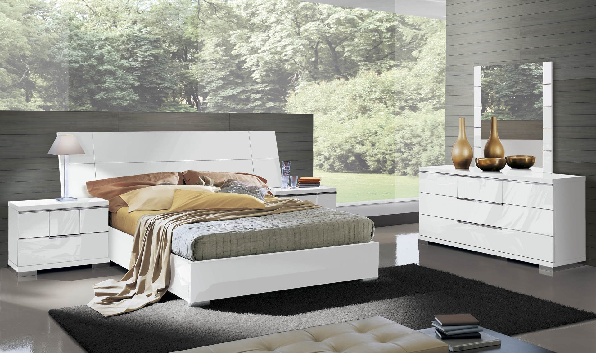 This Asti Platform Bed from Alf Italia will bring an elegant, contemporary look to your bedroom. It features a large panel headboard and a platform base in white high gloss.