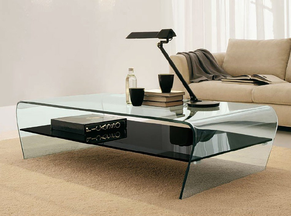 A coffee table that combines the lightness of curved glass, with a tempered glass, or wooden shelf