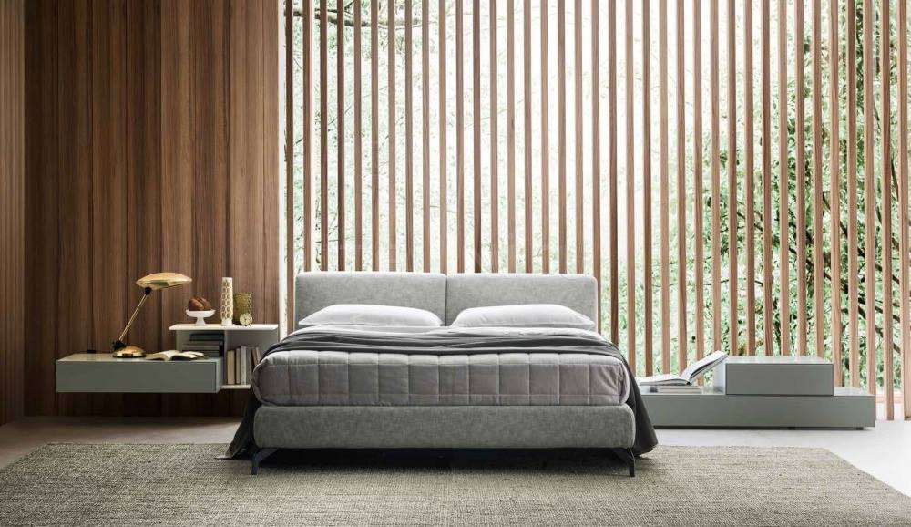 California is a padded bed available as a sofa bed or with metal feet