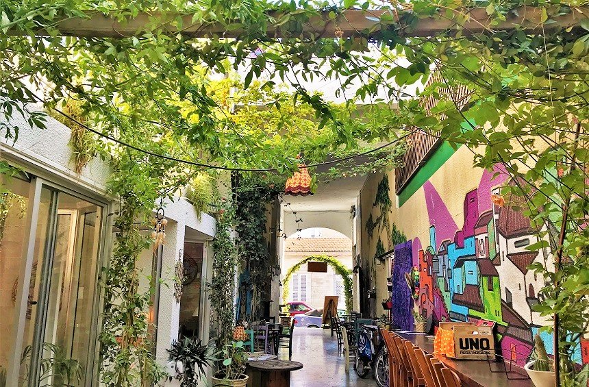 OPENING: A colorful hangout in the square, with a multi-colored, delicious menu!