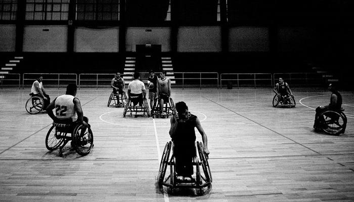 Can YOU shoot a basketball sitting on a wheel chair? Take a shot!