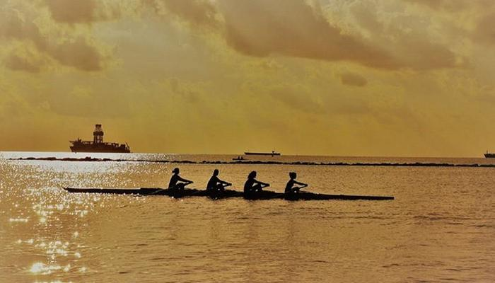 The picture of the rowers in the Limassol's sea at sunrise is pure art