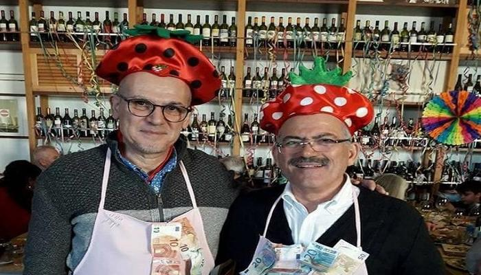 The Mayor served the people dressed as a strawberry!