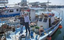 Andreas Christou with the President of fishermen association.