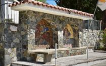 The main road is decorated with traditional stone walls and mosaic pictures on them.
